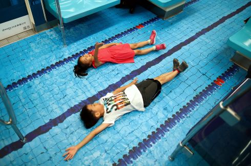 NICE BACKSTROKE: Children pose for a photograph inside a subway decorated as a swimming pool to promote the 29th Summer Universiade in Taipei, Taiwan. Taiwan will be hosting the Summer Universiade from August 19th-30th. Photograph: Ritchie B Tongo/EPA