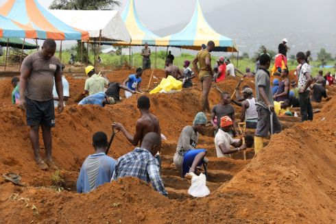 MUDSLIDE AFTERMATH: Workers are seen digging graves at Paloko cemetery in Waterloo, Sierra Leone. Photograph: Afolabi Sotunde/Reuters