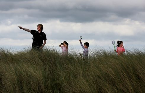 ADVENTUROUS FOUR: Padraic Creedon of Global Action Plan with Rosanna Drewilieu (7) from Killester, Dublin, Michael O'Brien (5) from Edenderry, Co Offaly, and his sister Hannah (3) on the look out for the natural heritage of Bull Island, Dublin, for National Heritage Week 2017. Photograph: Mark Stedman