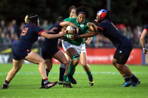WRAPPED UP: Ireland's Sophie Spence is tackled by the French defence during their 21-5 Women's Rugby World Cup defeat at UCD. Photograph: Niall Carson/PA Wire
