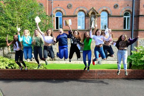 JUMPING FOR JOY: Students from St Dominic's Grammar School on the Falls Road in Belfast celebrate as about 30,000 A-level and AS-level students get their results. Photograph: Pacemaker Press