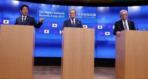 Japan's prime minister Shinzo Abe  with European Council president Donald Tusk and European Commission president Jean-Claude Juncker announcing a trade agreement last month