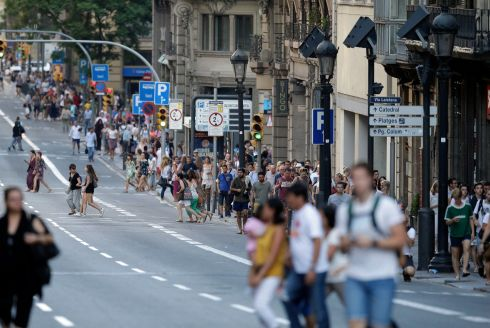 People walk down a main street in Barcelona, Spain. Photo: AP Photo/Manu Fernandez