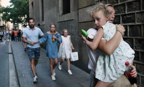 People flee the scene in Barcelona, Spain. Photo: AP Photo/Giannis Papanikos