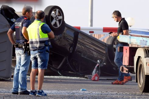 Policemen check a car involved in a terrorist attack in Cambrils, a city 120 kilometres south of Barcelona, on August 18, 2017. Photograph: Lluis Gene AFP/Getty