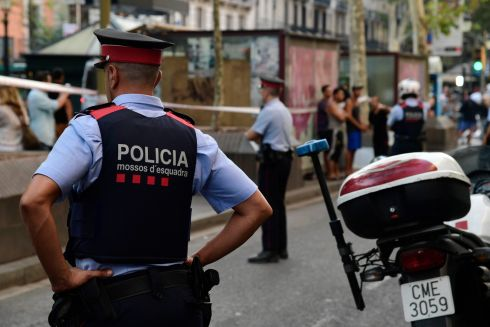 Spanish police officers stand guard on Las Ramblas a day after the attack. Photograph: Javier Soriano/AFP/Getty Images
