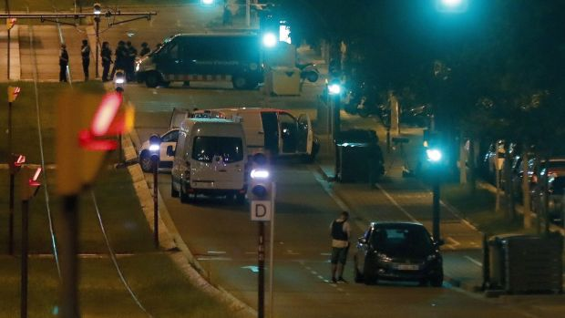 Spanish Police at the site where one of the alleged perpetrators of the Barcelonas terrorist attack, has died in the town of Sant Just Desvern, Barcelona, Spain, 17 August 2017, after a shoot-out with Catalonian police at a security checkpoint. Photograph: EPA