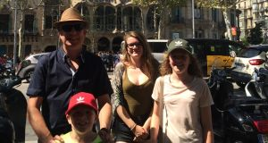 Wexford man Shane Kelly (48), and his children (from left) Rosa (14), Maisie (12) and Rudy (8) outside Casa Batlo in the center of Barcelona about an hour before the terrorist attack. Photograph: Alice Gilmour