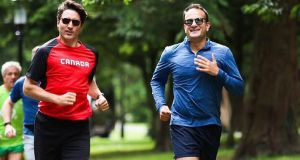 """Nice pace – shame about the maple leaf socks."" Canadian prime minister Justin Trudeau and Taoiseach Leo Varadkar jogging in the Phoenix Park. Photograph: PA Wire"