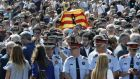 Policemen, residents and tourists observe a minute's silence in Barcelona's Plaça de Catalunya today to pay tribute to the terror attack victims. Photograph: EPA