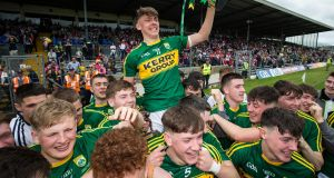 David Clifford and the Kerry players celebrate with the Munster title. Photograph: Cathal Noonan