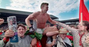 Mayo's Colm McMenamon celebrates with fans after beating Kerry in the 1996 All-Ireland SFC semi-final. Photograph: Inpho