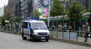 Finnish police patrol the streets in Helsinki after  stabbings in Turku. Photograph: Lehtikuva/Linda Manner/Reuters