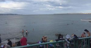 Swimmers at Seapoint on Thursday. The coast guard said 'many  terrified swimmers stayed out of the water due to the dangerous behaviour' of two jet skis. Photograph: Dun Laoghaire Coast Guard
