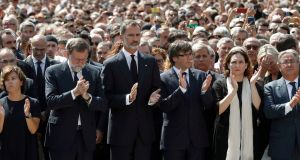 (L-R) Spanish vice prime minister Soraya Saenz de Santamaria, prime minister Mariano Rajoy, Spain's King Felipe VI, Catalonian regional president Carles Puigdemont, Barcelona's mayor Ada Colau and Spanish home minister Juan Ignacio Zoido attend a ceremony to pay respect for the terrorist attacks victims at Plaça de Catalunya in barcelona. Photograph: Andreu Dalmau/EPA.