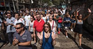 People march along Las Ramblas after observing a minute's silence following Thursday's terrorist attack. Photograph: Carl Court/Getty Images