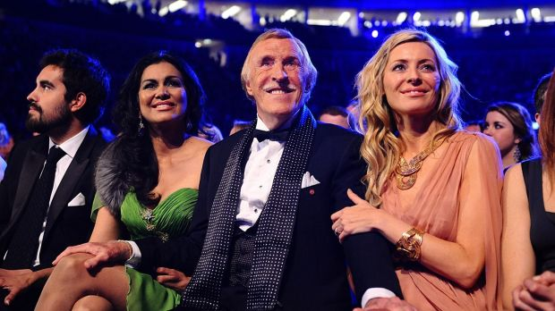Bruce Forsyth with his wife Wilnelia (left) sitting with Tess Daly as he wins a Special Recognition award, at the 2011 National Television Awards. Photograph: Ian West/PA