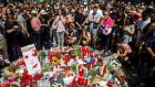 People pay tribute on Friday, outside the Liceu theatre in Barcelona, to victims of Thursday's attack. Photograph: Quique Garcia/EPA