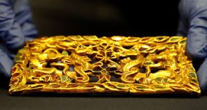 A golden artefact at the British Museum in London. Investors are driving gold prices higher as they worry over stocks. Photograph: AP