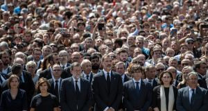 King Felipe VI of Spain and Spanish prime minister Mariano Rajoy join other dignitaries and residents of Barcelona in Placa de Catalunya on Friday to observe a minute's silence for the victims of the prevoius day's terrorist attack. Photograph: Carl Court/Getty Images