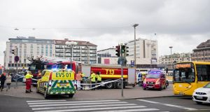 Ambulances gather at the site of a multiple stabbing  in Turku, Finland. Photograph: Stringer/EPA
