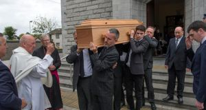 Michael Twomey's remains are carried from  St Michael's Church. Photograph: Michael Mac Sweeney/Provision