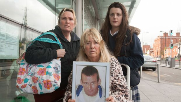 From left Derek Devoy's sister Antoinette Corbally, her mother Anne Devoy and her neice Andrea Devoy. Anne Devoy is holding a picture of Michael Devoy who was shot dead in 2014. File photo: Gareth Chaney Collins