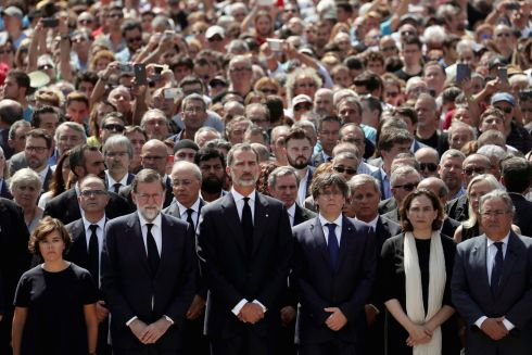 MINUTE'S SILENCE: Spanish deputy prime minister Soraya Saenz de Santamaria, prime minister Mariano Rajoy, King Felipe of Spain, president of the Generalitat of Catalonia Carles Puigdemont, Barcelona's mayor Ada Colau and Spanish interior minister Juan Ignacio Zoido lead a minute of silence at Placa de Catalunya. Photograph: Susana Vera/Reuters