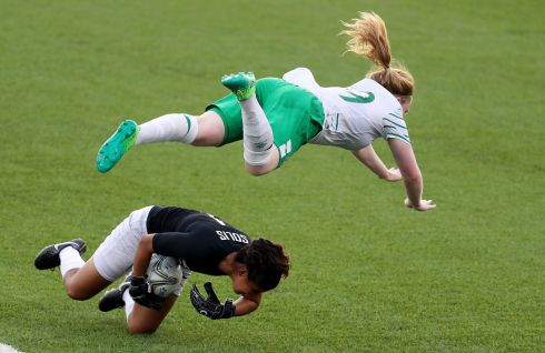 WON THE BALL REF! Ireland's Ambra Barrett challenged by Mexico's Ofelia Solis Garza at the World University Games at Hsinchu County Second Stadium, Taipei, Taiwan. Photograph: Tommy Dickson/Inpho