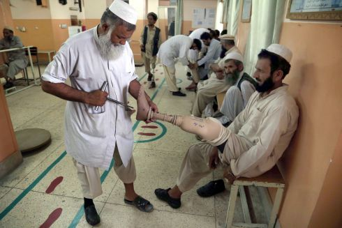 RED CROSS: Afghan men get their artificial limbs installed, during a programme for disabled supported by the International Committee of the Red Cross (ICRC) in Jalalabad, Afghanistan. The ICRC centre in Jalalabad is visited daily by 100 to 150 patients. Photograph: Ghulamullah Habibi/EPA