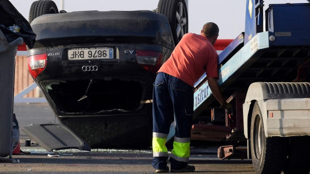 An employee starts to tow away a car involved in a terrorist attack in Cambrils, 120km south of Barcelona, on Friday morning. Photograph: Luis Gene/AFP/Getty Images