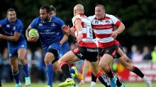 Leinster's Isa Nacewa is challenged by Willi Heinz of Gloucester during the pre-season game at Templeville Road. Photograph: Ryan Byrne/Inpho