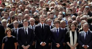 Spanish deputy prime minister Soraya Saenz de Santamaria, prime minister Mariano Rajoy, King Felipe, president of Catalonia Carles Puigdemont, Barcelona mayor Ada Colau, and Spanish interior minister Juan Ignacio Zoido, observe a minute's silence at Placa de Catalunya in Barcelona on Friday in honour of those killed in Thursday's terror attack on Las Ramblas. Photograph: Susana Vera/Reuters