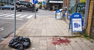 Blood stains remain on the sidewalk at the site of one of the multiple stabbings, on Puutori Square in Turku. Photograph: Ari Matti Ruuska/Turun Sanomat/EPA