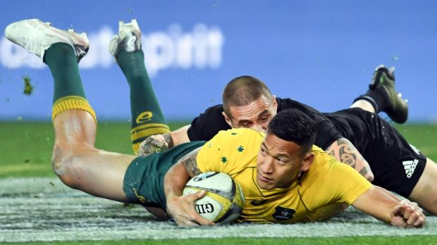 Israel Folau scores for Australia in the second half of their defeat to New Zealand. Photograph: Saeed Khan/AFP
