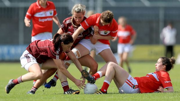 Cork's Eimear Scally and Shauna Kelly with Emer Flaherty and Megan Glynn of Galway. Photograph: Donall Farmer/Inpho