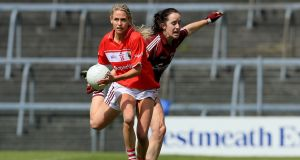Cork's Orla Finn goes past Lisa Gannon. Photograph: Donall Farmer/Inpho