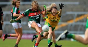 Donegal's Katy Herron tries to block Sarah Rowe of Mayo. Photograph: Donall Farmer/Inpho