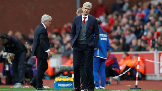 Arsenal manager Arsene Wenger and Stoke City manager Mark Hughes. Photograph: Carl Recine/Reuters