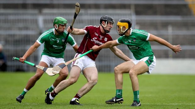 Galway's Sean Linnane with Robbie Haley and Thomas Grimes of Limerick. Photograph: Ryan Byrne/Inpho