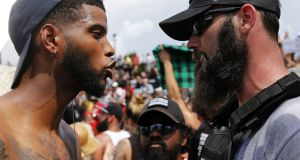 Protesters and counter-protesters argue during a demonstration in New Orleans, Louisiana, on Saturday. Photograph: Jonathan Bachman/Getty Images