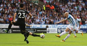 Aaron Mooy scores  Huddersfield Town's goal in the  the Premier League win over  Newcastle United at John Smith's Stadium. Photograph: David Rogers/Getty Images