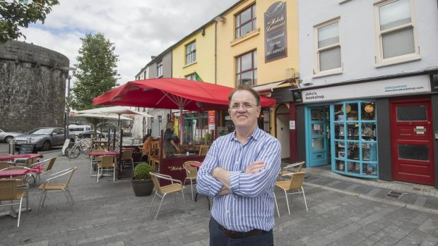 "John Donohoe, antiquarian bookseller, outside his bookshop in Athlone: ""I have always liked the idea of collecting everything by one writer."" Photograph: Brenda Fitzsimons"