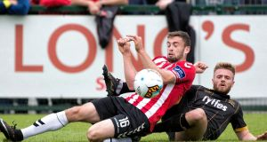 Derry's Nathan Boyle is challenged by Dundalk's Conor Clifford. Photograph: Evan Logan/Inpho