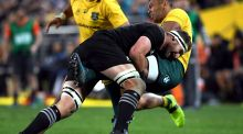 Australia's centre Kurtley Beale is tackled by New Zealand's No 8 Kieran Read during the Rugby Championship test match between Australia and the New Zealand All Blacks in Sydney.  Photograph: William West/AFP/Getty Images