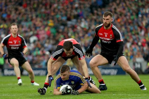 ALL-IRELAND CLASH: Mayo's Colm Boyle, Chris Barrett and Aidan O'Shea with James O'Donoghue of Kerry during their All-Ireland football semi-final at Croke Park. Photograph: INPHO/James Crombie