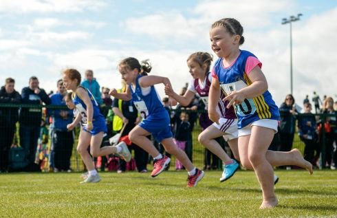 BEST FOOT FORWARD: Izzy Masterson, from Co Longford, competes barefoot in the U8 girls 60m race at the Aldi Community Games, at the National Sports Campus, Dublin. Photograph: Cody Glenn/Sportsfile
