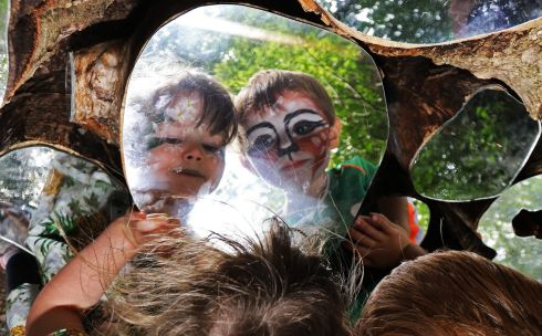 ON REFLECTION: Little Finn Lee (3) and Anu Hughes (4) gaze on their reflections in an art piece by wood artist Joe Doherty, at Ballyhaise Agricultural College, Co Cavan. Photograph: Lorraine Teevan