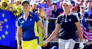 Catriona Matthew of Team Europe and Stacy Lewis of the United States leave the first tee during the final day singles matches of the Solheim Cup  in West Des Moines, Iowa on Sunday. Photograph:  Harry How/Getty Images