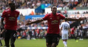 Manchester United's Anthony Martial celebrates his goal against Swansea at Liberty Stadium on Saturday with co-scorer Paul Pogba (left). Photograph: Dimitris Legakis/EPA